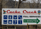 Billboards along Highway 99 direct travellers to Cache Creek by informing them of amenities within the community.