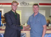 Evan van Dyk meets with Rob Dyke, owner Tower Radio, a small business located in Terrace.